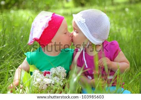 cute little girls in park - stock photo