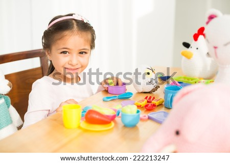 Cute little girls playing with her toys - stock photo