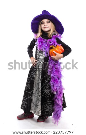 Cute little Halloween witch holding a orange pumpkin. Studio portrait isolated over white background  - stock photo