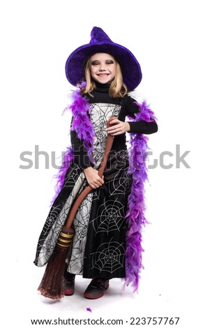 Cute little Halloween witch with broom. Studio portrait isolated over white background  - stock photo