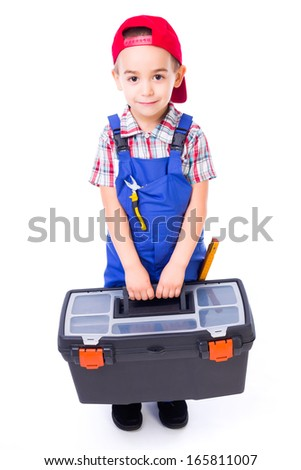 Cute little handyman boy carrying big toolbox and pliers in pocket - stock photo