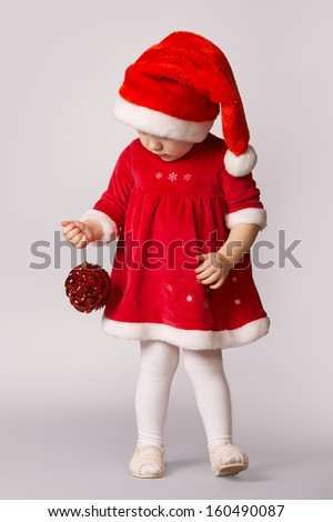 cute little happy girl with christmas ball - stock photo