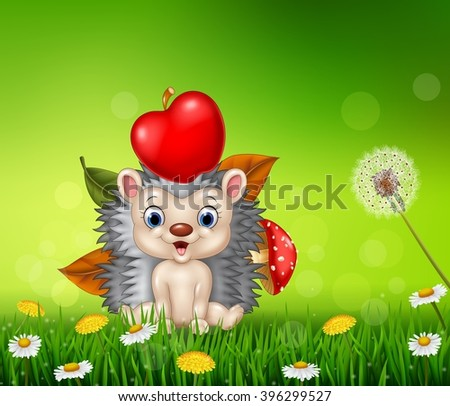 Cute little hedgehog in the beautiful grass background - stock photo