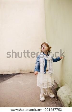 cute little  hipster girl urban portrait - stock photo