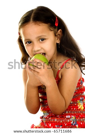 Cute little Indian girl eating apple - stock photo