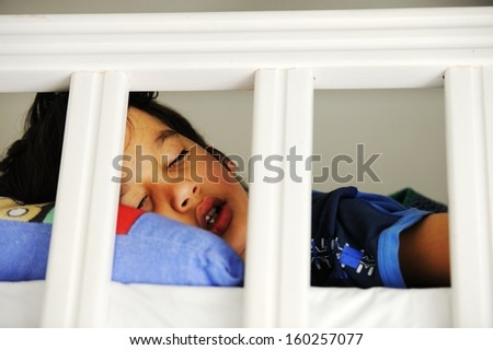 Cute little kid sleeping - stock photo