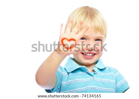 Cute little kid with painted heart shape on his hand - stock photo