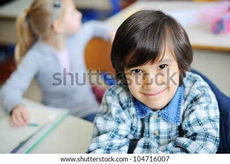 Cute little kids in school - stock photo