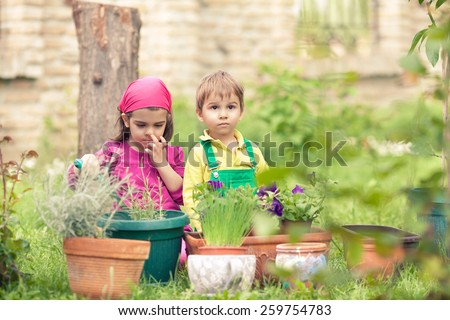 Cute little kids playing in front or back yard - stock photo