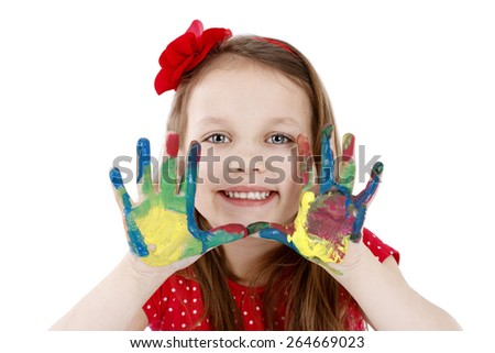 Cute little painter with dirty hands - isolated studio portrait - stock photo