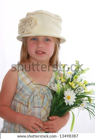 cute little preschool age girl with vintage hat, summer dress and flowers. - stock photo