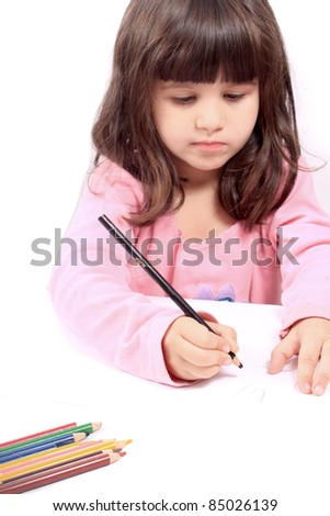Cute little preschool girl  drawing with pencils on white - stock photo