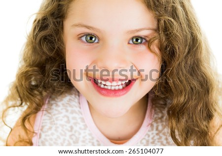 Cute little preschooler girl with chocolate milk mustache isolated on white - stock photo