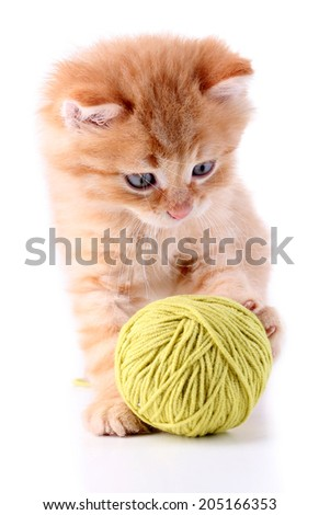 Cute little red kitten and ball of thread isolated on white - stock photo