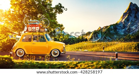 Cute little retro car with suitcases and bicycle on top goes by wonderful countryside road at sunset. 3D Illustration - stock photo