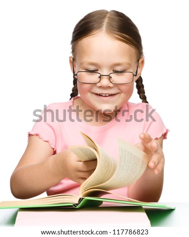 Cute little schoolgirl with a book wearing glasses, isolated over white - stock photo