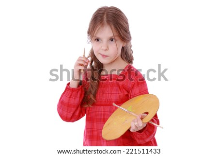 cute little talented girl painting/A young girl with a palette on Art theme - stock photo
