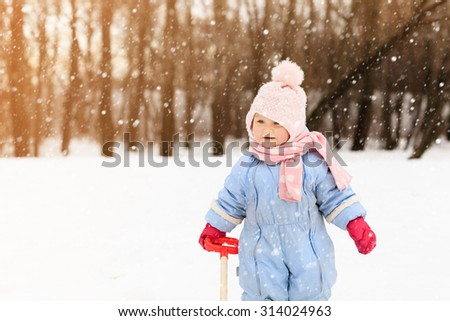 cute little toddler girl in winter snow - stock photo
