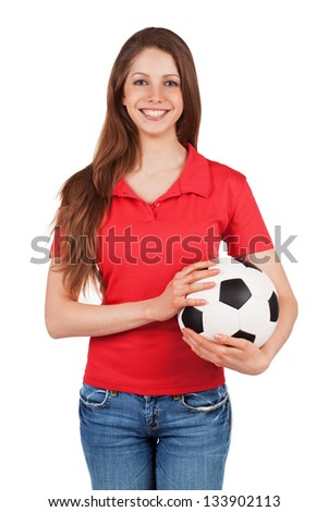 Cute long-haired girl holding a soccer ball - stock photo