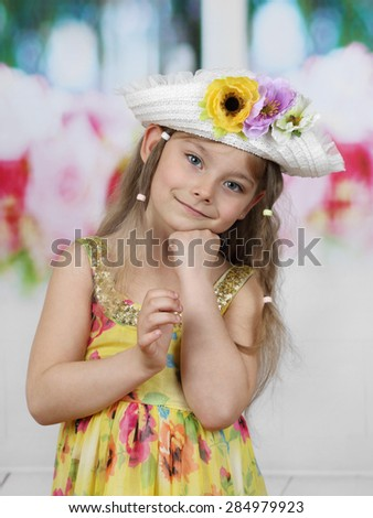 Cute long haired girl in flowers decorated hat portrait - children beauty and fashion concept - stock photo