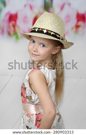 Cute long haired girl in hat portrait - children beauty and fashion concept - stock photo