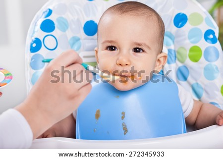Cute lovely baby likes to make mess in the kichen - stock photo