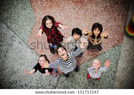 Cute lovely school children at clasroom having education activities - stock photo
