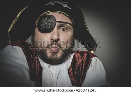 Cute, man pirate with eye patch and old hat with funny faces and expressive - stock photo
