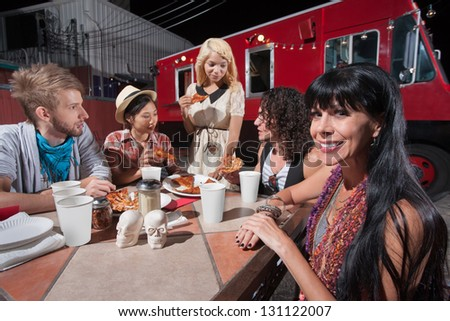 Cute mature hipster with young friends eating pizza - stock photo