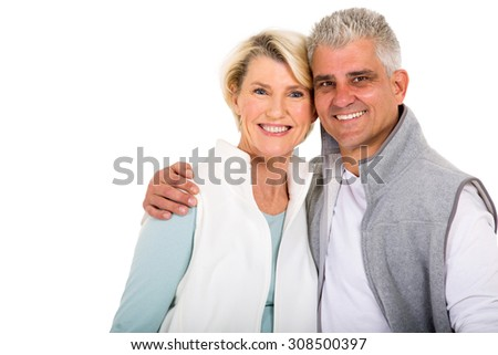 cute middle aged couple looking at the camera - stock photo