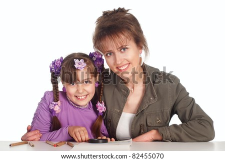 cute mom draws with her little girl - stock photo