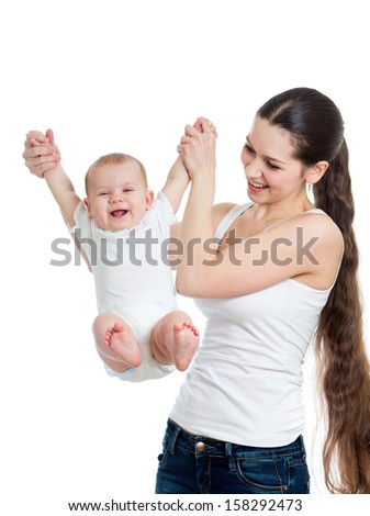 cute mother playing with her baby isolated - stock photo