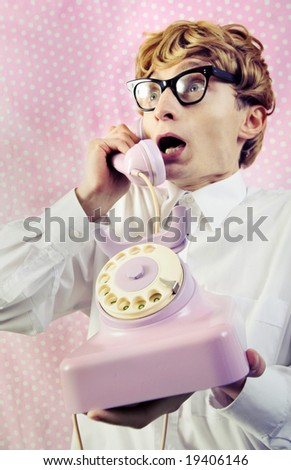 Cute nerd gossiping on the phone - a bit shocked this time - stock photo