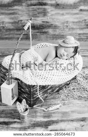 cute newborn baby boy sleeping in a hat fisherman ( black and white ) - stock photo