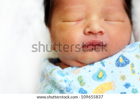 Cute newborn baby boy sleeping portrait - stock photo