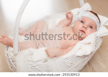 Cute newborn baby girl 1 month child sleeping in basket, adorable little girl new born kid portrait, happy baby portrait, beautiful little girl , soft tonality, series - stock photo