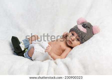 cute newborn baby in knitted cap - stock photo