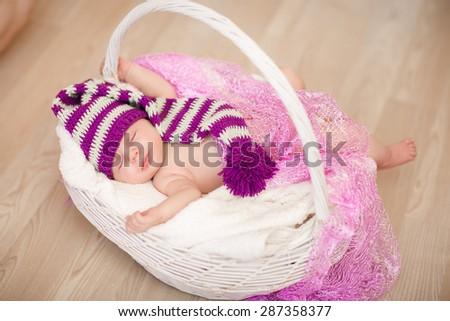 Cute newborn baby 1 month child sleeping in basket, adorable little girl new born kid portrait, happy baby portrait, beautiful little girl , soft tonality, series - stock photo