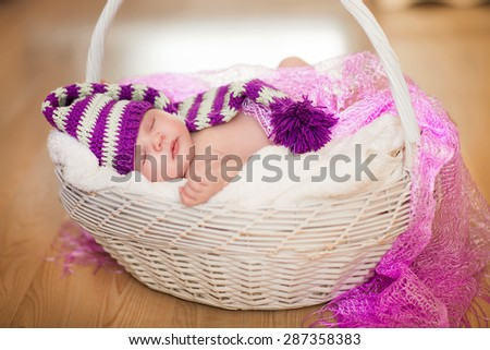 Cute newborn baby 1 month child sleeping in basket, adorable little girl new born kid portrait, happy baby portrait, beautiful little girl , soft tonality, series - stock photo