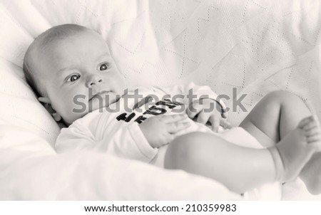 cute newborn boy wearing clothing with love to mum  (not trademark) ( black and white ) - stock photo