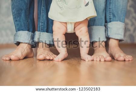 Cute newborn foot with family members - stock photo