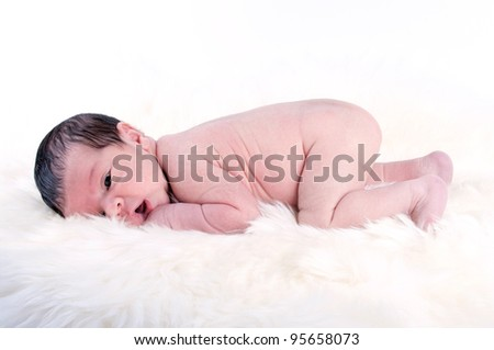 Cute one week old baby boy on white background - stock photo
