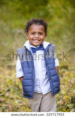 Cute outdoor portrait of a smiling African American boy - stock photo