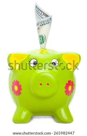 Cute piggy bank with hundered US dollars in it - stock photo