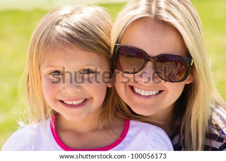 Cute Portrait of a Mother and her daughter - stock photo
