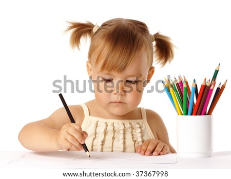 Cute preschooler focused on drawing, isolated over white - stock photo