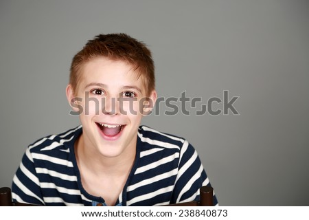cute preteen blond boy with mouth open wide - stock photo