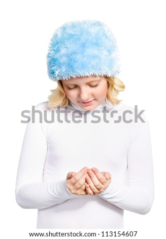 Cute preteen girl wearing winter outfit watching to her folding hands. Concept Christmas wish. isolated over white - stock photo