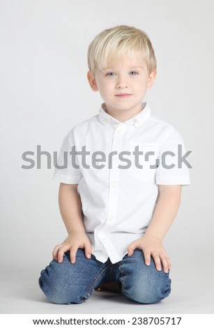 Cute, pretty boy posing in studio - stock photo