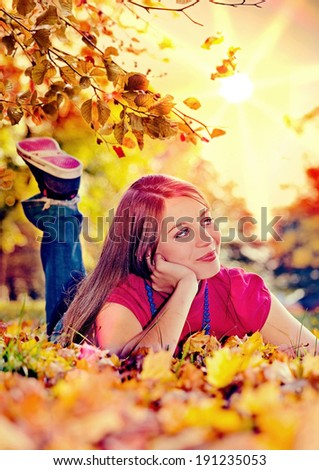 cute pretty girl in an autumn-park - stock photo